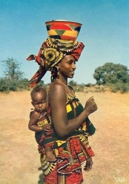 Africa | Mother with her baby. | Scanned postcard; published by IRIS