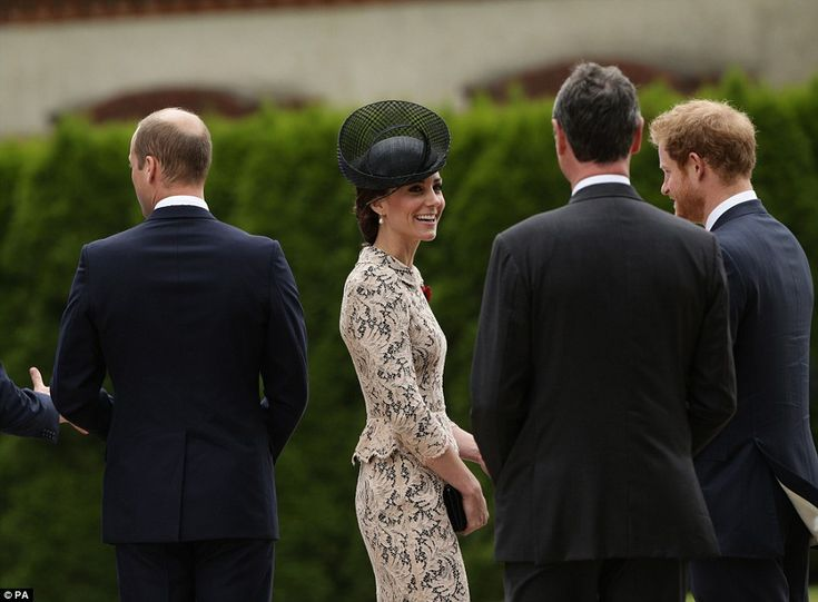 The Duchess of Cambridge was seen speaking to Prince Harry, right, as her husband William, left, spoke to another dignitary at the event