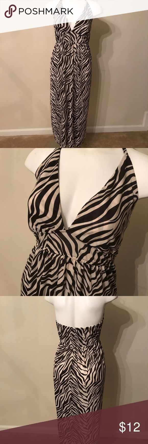 """Maxi Halter strap dress animal print plus size Low cut V-neck halter that ties behind neck, tan and cream animal print stripes, cotton material, back is open, good for the summer, good for the beach, it's long-I'm 5'8"""" and it goes to the floor. Faded Glory Dresses Maxi"""