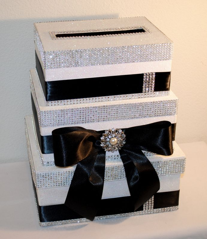 """A classic Wedding Card Reception Box - beautiful 3 tier box with """"bling"""", black satin ribbon against a white glitter background. A Bow cascades down the front with pearl and rhinestone pendant in the center. Truly, this is a stunning CARD BOX. CUSTOM ORDERS TOO!! #Weddingcardboxes"""