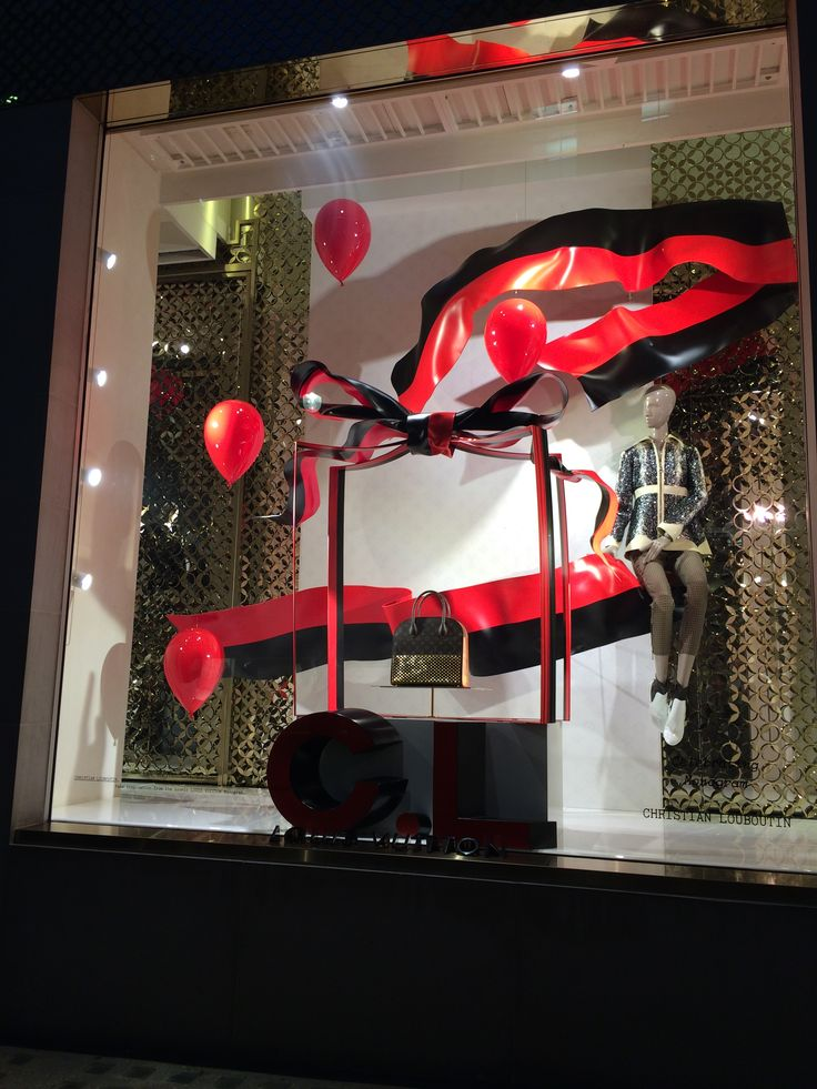 Louis Vuitton 'Celebrating Monogram' Display woth Collaboration with Christian Louboutin