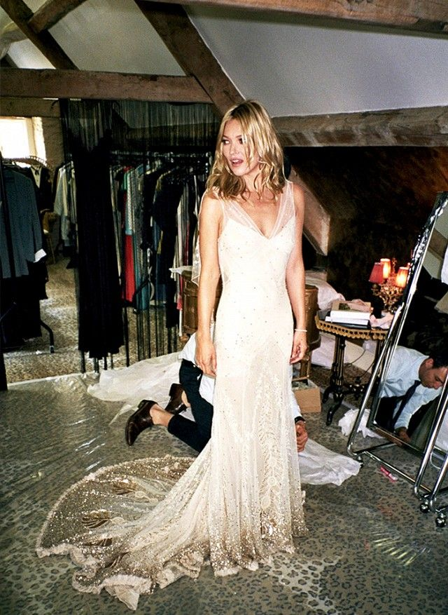 The 15 Most Gorgeous Wedding Dresses to Ever Grace the Pages of Vogue via @WhoWhatWear | Kate Moss in custom John Galliano