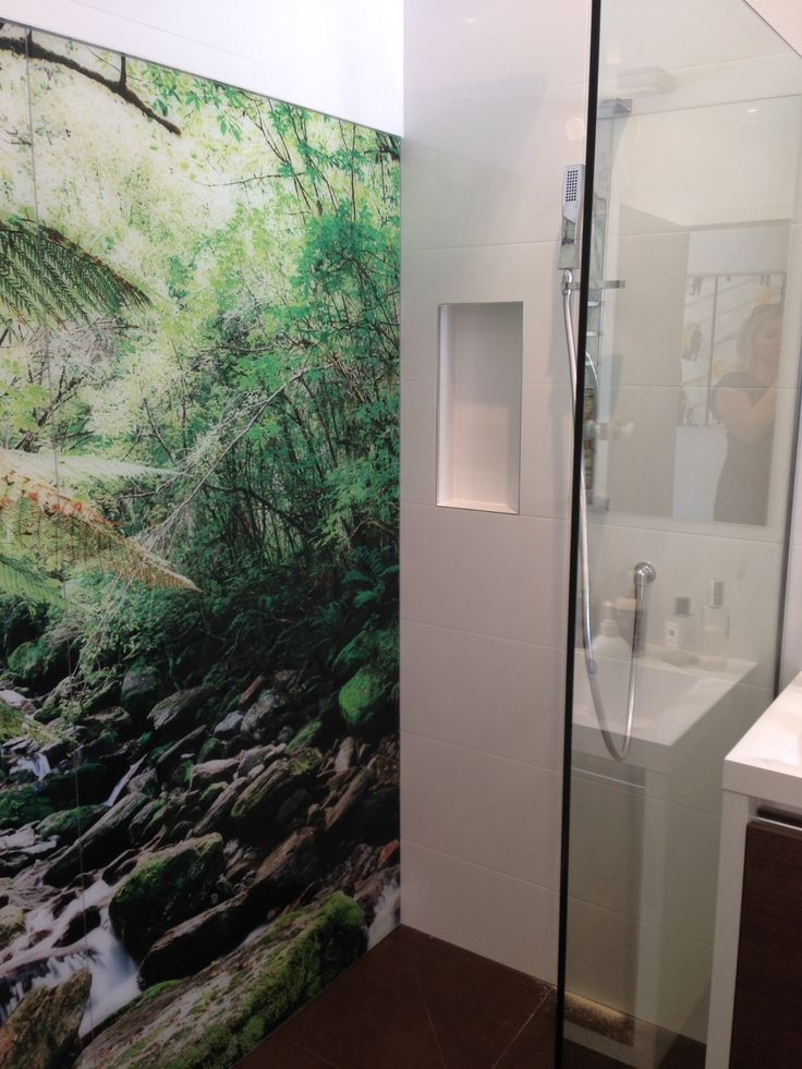 A stunning image of New Zealand forest on a glass wall in a shower in a family bathroom.