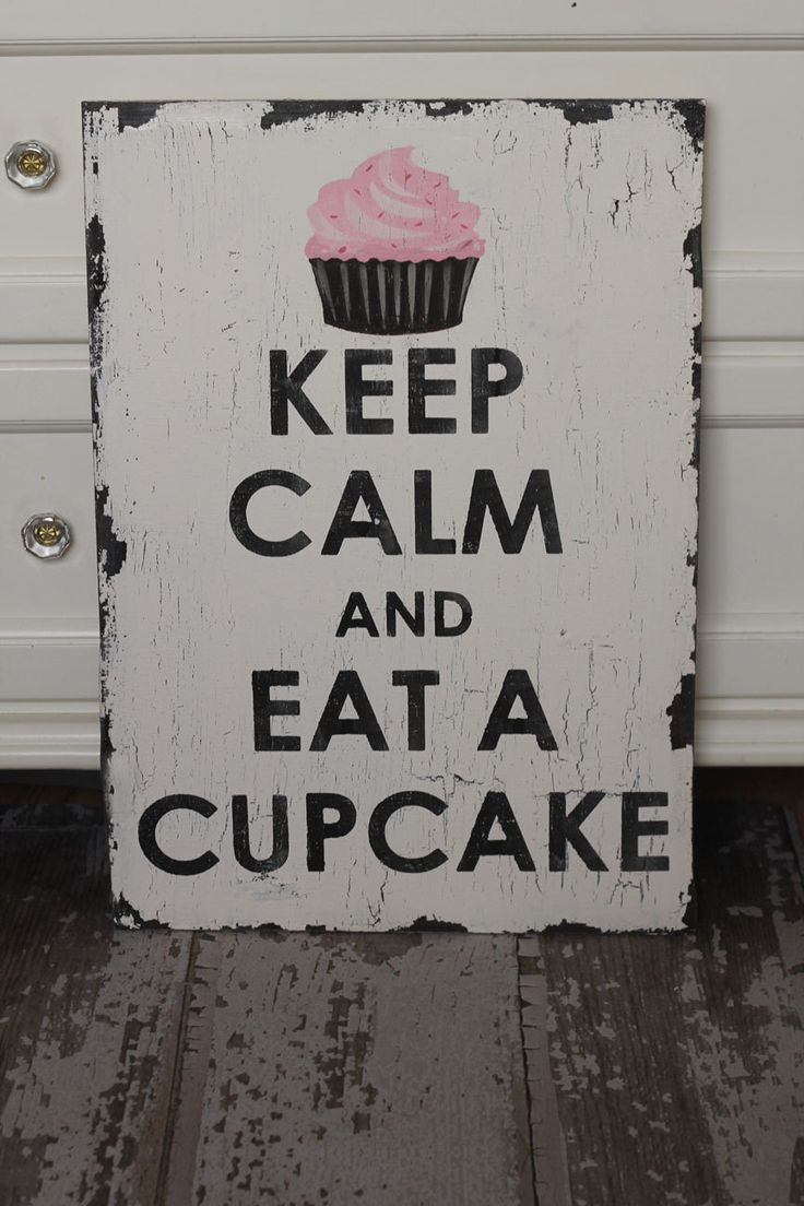 $48.00 - Etsy.  Keep Calm and Eat a Cupcake VINTAGE shabby chic sign - I might just need this.
