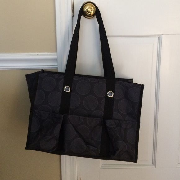 Thirty-One utility tote Black utility tote from Thirty-One. Gently used, but wasn't big enough to fit my needs. Plenty of pockets on the outside, zip top. Measures approximately 14.5 inches width, 11 inches in height. Handles also measure about 11 inches from top of handle to top of bag Thirty One Bags Totes