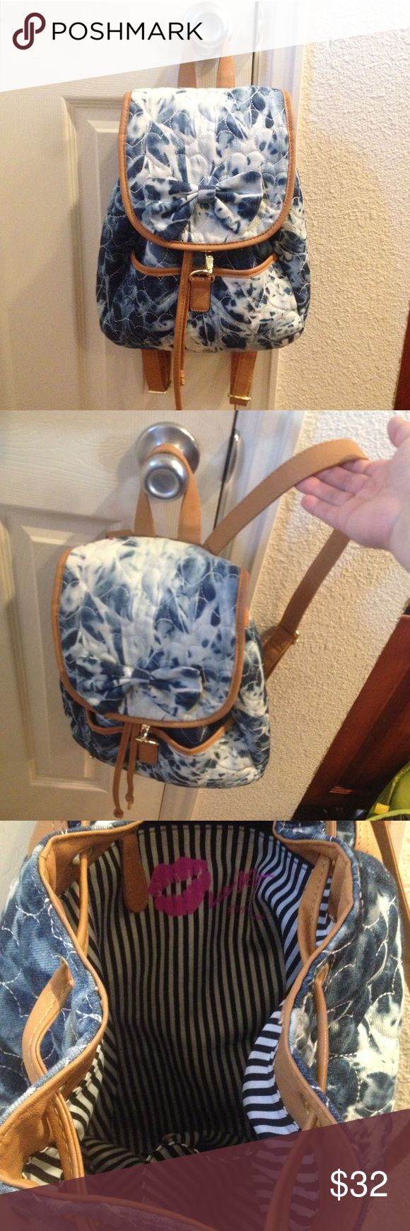 Betsey Johnson Tie Dye Heart Backpack Luv Betsey Tie dye denim backpack with hearts stitched throughout and a bow. Almond colored leather and gold hardware. Black and white striped interior. This bag is amazing! Used very lightly a few times Betsey Johnson Bags Backpacks