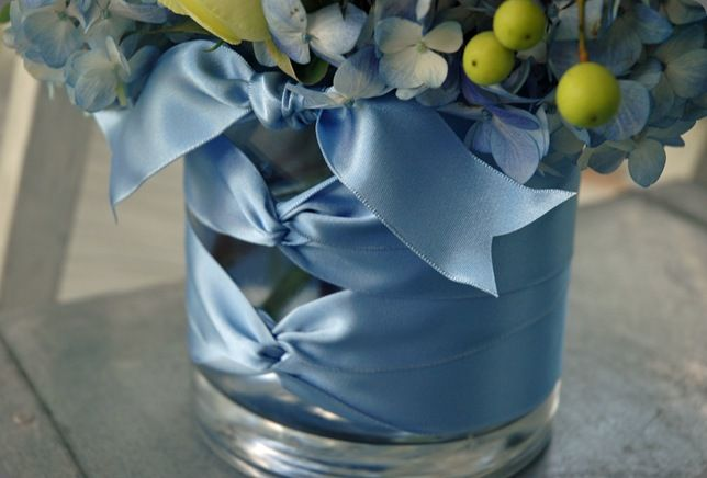 centerpiece vase with braided ribbon