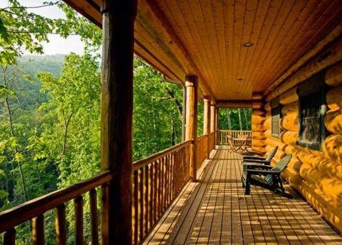 Dream house & porch! I love log cabin houses!!