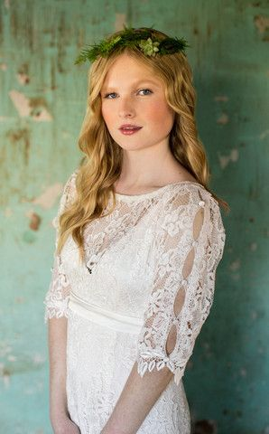 Anna by Martin McCrea | All-over guipure lace wedding dress with empire waist and mid length sleeves. Satin button detail down each sleeve and back of gown. Available in plus size and custom sizes.