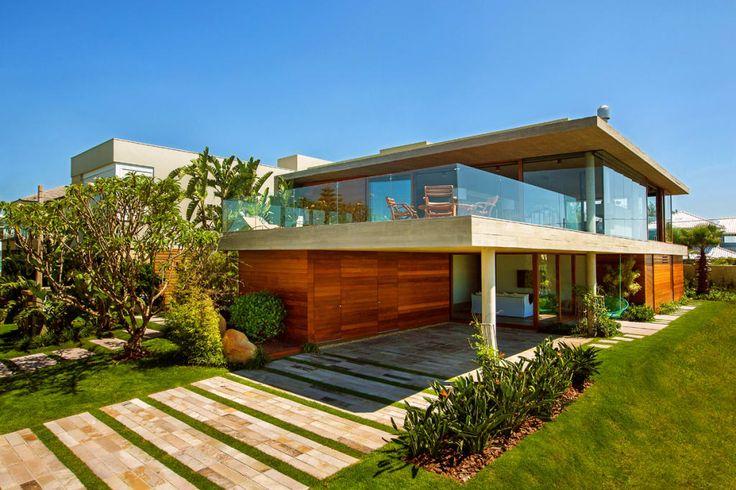 Busca imágenes de diseños de Casas estilo moderno de Stemmer Rodrigues. Encuentra las mejores fotos para inspirarte y crear el hogar de tus sueños.