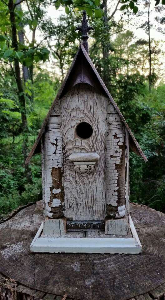 Old tool box birdhouse.