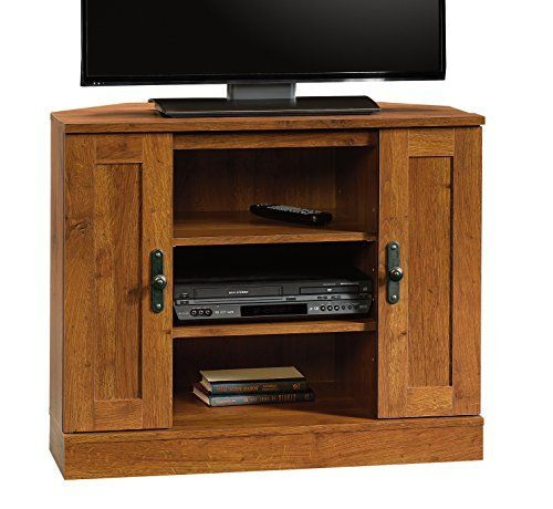 """The Harvest Mill Panel TV Stand by Sauder has an Abbey Oak finish. It accommodates up to a 42"""" TV weighing 95 lbs. or less. Divided shelving provides dedicated storage for audio/video components. It features an adjustable center shelf. Storage area behind doors holds CDs and... more details available at https://furniture.bestselleroutlets.com/game-recreation-room-furniture/tv-media-furniture/television-stands-entertainment-centers/product-review-for-sauder-harvest-mill-c"""