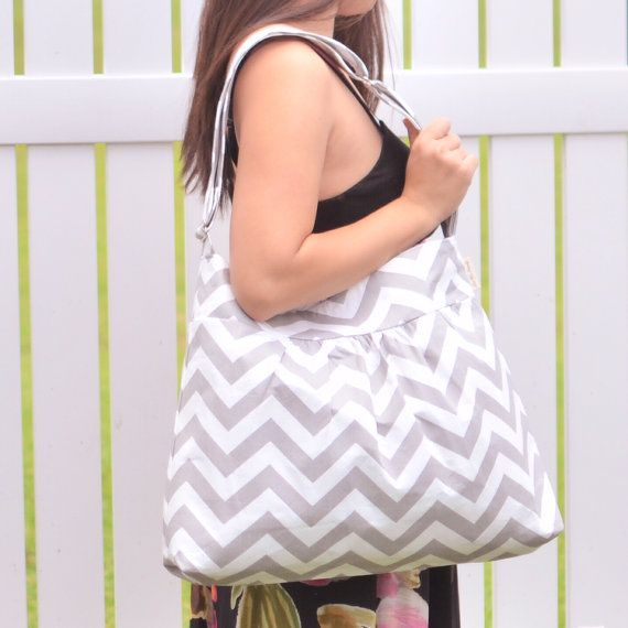 Large Diaper Bag Chevron Grey    This large diaper bag can be used as a School Bag, everyday bag, or anything else you may like.    Bag Exterior: