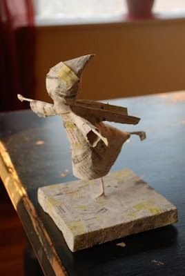 papier mache figure tutorial: wire armature foot loop is screwed to wood block, figure shaped with aluminum foil, covered in newspaper, paper mache, then painted
