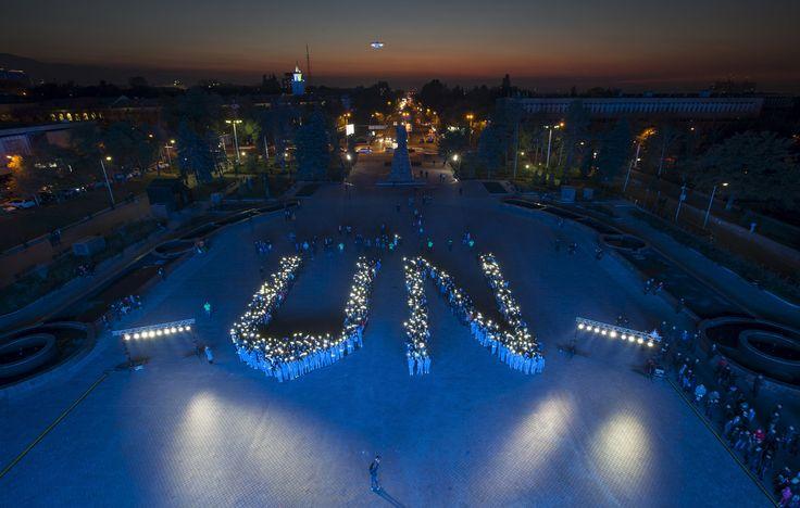 Students form a UN tribute in Almaty, Kazakhstan.  Photograph: Shamil Zhumatov/Reuters