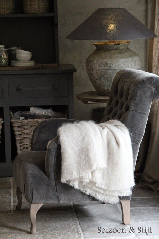 "seizoen en stijl. (Season and style). Grey velvet tufted chair with rustic grey surroundings. from a Dutch board ""Rural Living"":"
