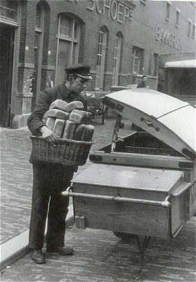 """And here is the baker bringing fresh baked bread...and rolls and """"krenten-brood"""" (raisin bread) to our door. Great service for sure....don't have this anymore today..."""