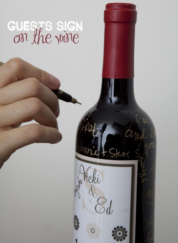 Guest Book Wine bottles! Guests sign the bottles, (which have customized labels of course) and then you drink them on your anniversaries! COOL!