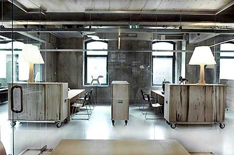 industrial office space - concrete flooring, exposed pipies and