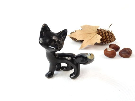 """A vintage black fox figurine. This ceramic fox was handmade and handpainted - the designer and artist unknown. A lovely addition to your animal figurine collection or a unique desk or shelf decor.   CONDITION: good vintage condition, two small paint chips on the ears (please see photos)  MEASUREMENTS: 3.5"""" x 4"""" wide // 9 cm x 10 cm"""