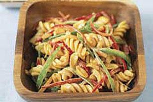 This Asian salad of pasta, carrots, pea pods and red peppers is tossed with a creamy peanut dressing flavored with lime juice, honey and soy sauce.
