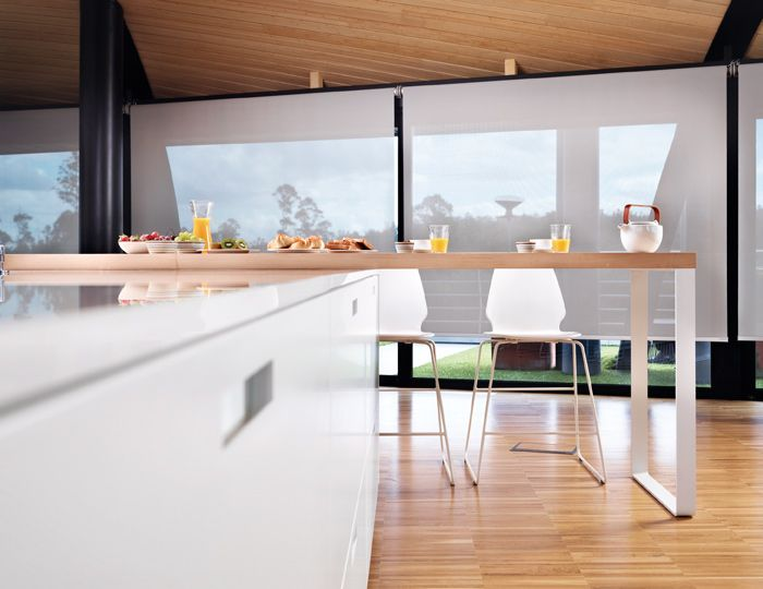 SANTOS kitchen. Attached to the island, a solid wooden bar with a metallic structure offers an auxiliary work place, for having light lunches, breakfast or just for a moments rest.