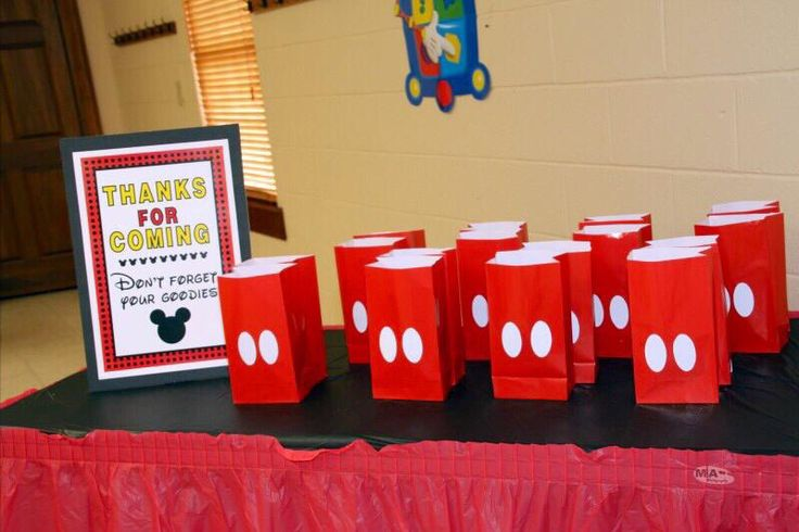 Mickey Mouse DIY goodie bags. Red treat bags with button die cuts placed on with zots for a 3-D affect