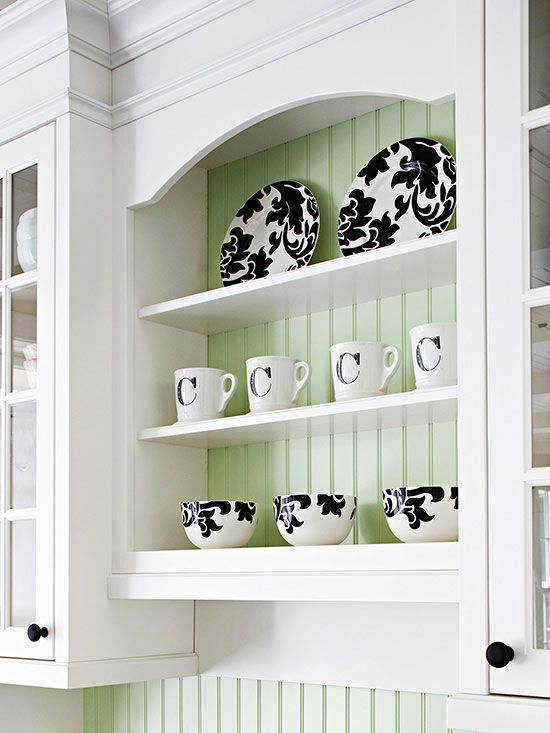 Crown molding and picturesque arrangements make simple cabinetry look polished and elegant.