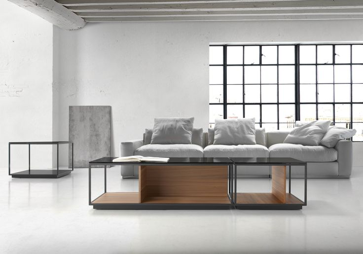 | RITA - Designed by: Antoni Arola | Collection of coffee tables composed by black microtexturated thermo-lacquered metal structure, base and vertical sides in walnut, oak or lacquer and top in smoke grey glass (10 mm).