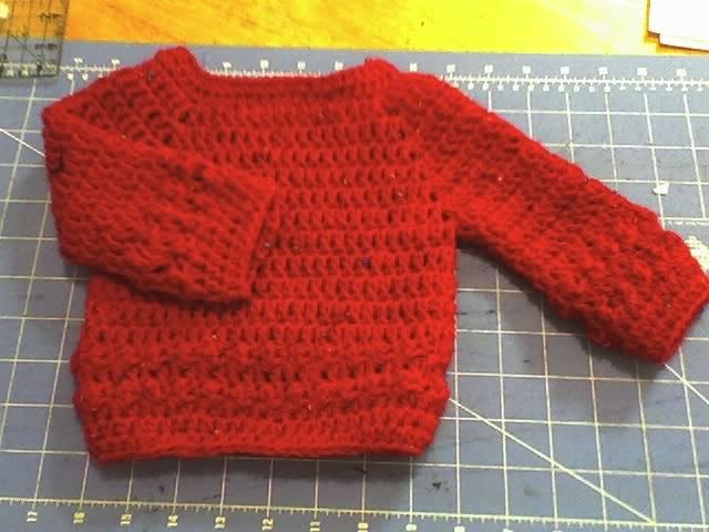 I just had to do it, I had already designed patterns for the hat and booties, I just had to crochet a sweater to match. This months project...