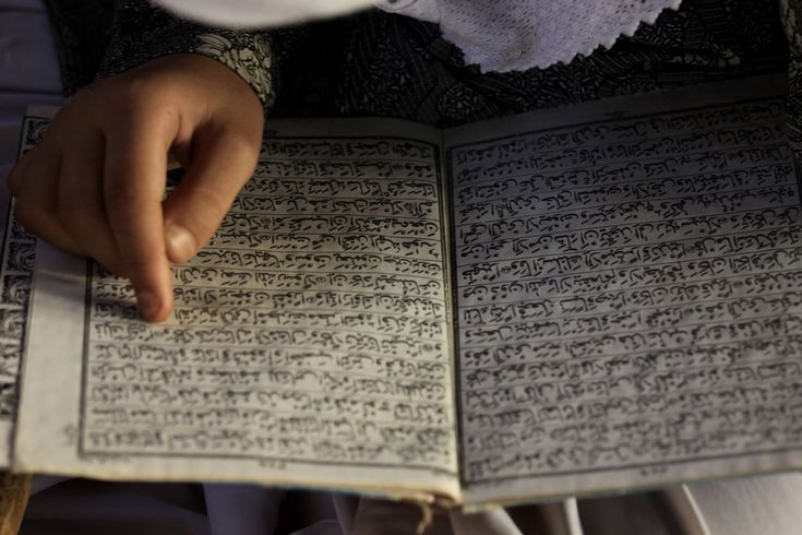 Girl from Kashmir reads the Koran at a local madrassa, a Muslim religious school, during the holy month of Ramadan in the Indian city of Srinagar.