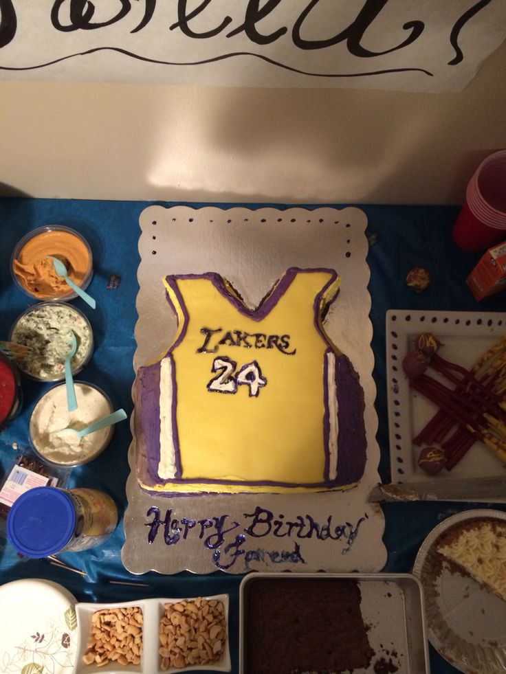 I made this Lakers jersey cake for my husbands birthday. And the cake balls to match the Lakers theme. The marshmallow fondant I made wasn't working so well so I had to use frosting as well. And the kids ruined the writing by the time this pic was taken.