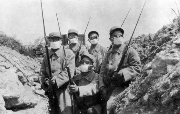MASKED TROOPS French troops wearing a form of gas mask in the trenches during the Second Battle of Ypres, circa 1915.