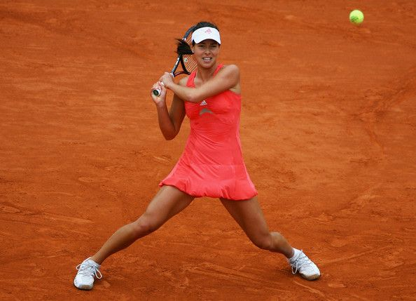 Ana Ivanovic Photos Photos - Ana Ivanovic of Serbia hits a backhand during the Women's Singles Quarter Final match against Patty Schnyder of Switzerland on day ten of the French Open at Roland Garros on June 3, 2008 in Paris, France. - French Open - Roland Garros 2008
