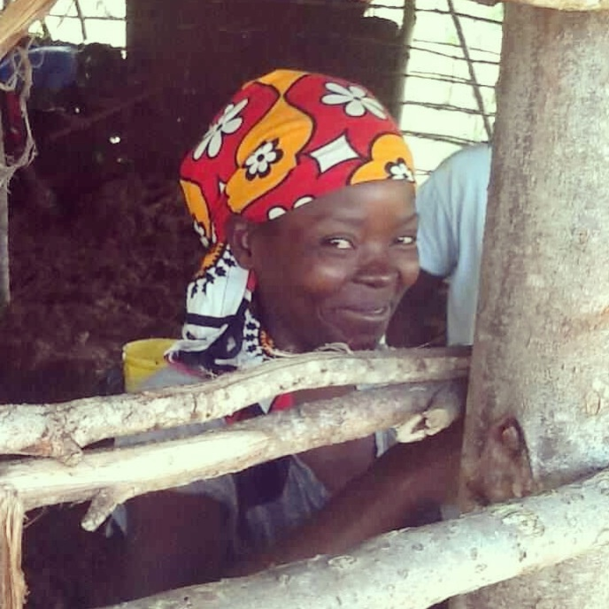 A beautiful local villager coming to help us build one of our huts at the Suluhisho children's village. Such a gorgeous smile. Join us by volunteering www.suluhisho.com