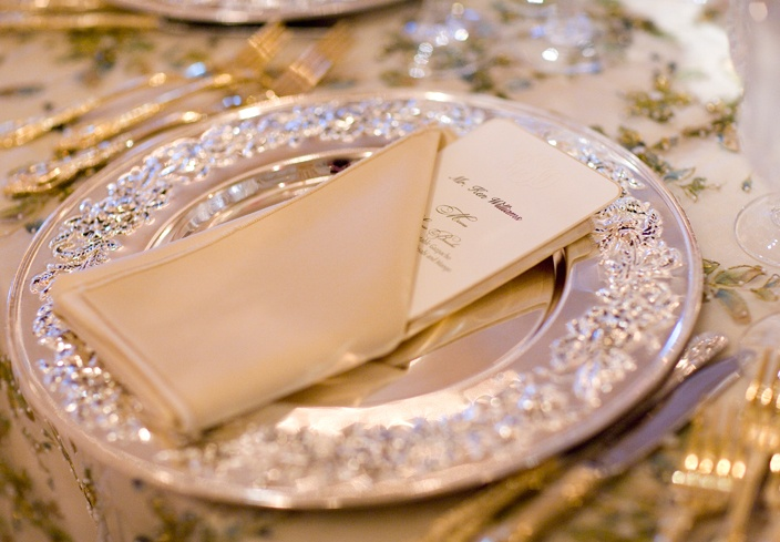 I like the menu/napkin fold (esp if the paper would be handmade... o the luxury would be in one touch)