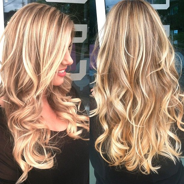 Beachy blonde highlights on top, color melt everything else from light brown to blonde, long layers & loose waves