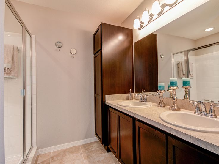 Pic On Dual vanities and plenty of storage make everyday life more organized and convenient Highland Homes
