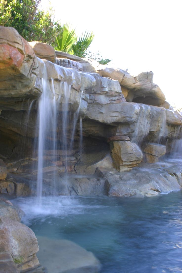 Hand carved sandstone grotto and embankment. Waterfalls generate wonderful sounds that calm the space, while generating interest. Amazing rock replication.