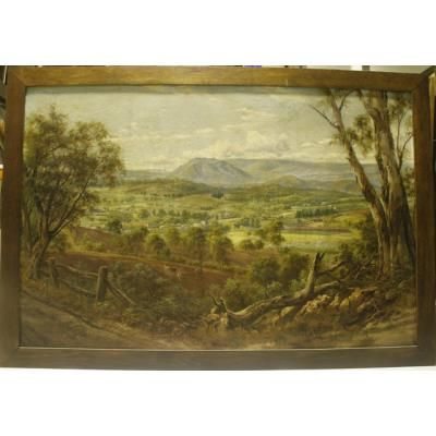 Large, framed, colour painting by J.A. Turner, c. 1899, of a view over Lilydale, painted from the corner of the Maroondah Highway and Victoria Road, Lilydale. The painting features cleared land being worked by two horses and a plough in the foreground, and houses, buildings, fields and mountains in the background.