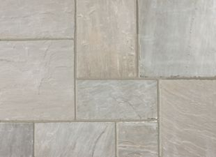 Marshalls Indian Sandstone Textured Grey Multi 560 x 275 x 15-25mm Paving Slab - Pack of 128 | Wickes.co.uk