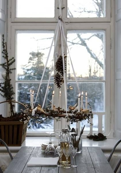 advent wreath hanging on the top of the dining table