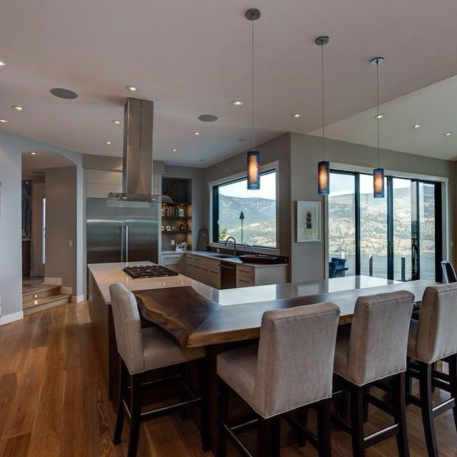 We love a kitchen with a good lake-view! #lakeview #kelowna #moderndesign #design #house #home #cabinets #nature #wood #custommade #kitchendesign #interiordesign #view #beach #mountains #potlights #hardwood #carolynwalshckd #magpieinteriors #hamlethomes #phoenixkitchenworks