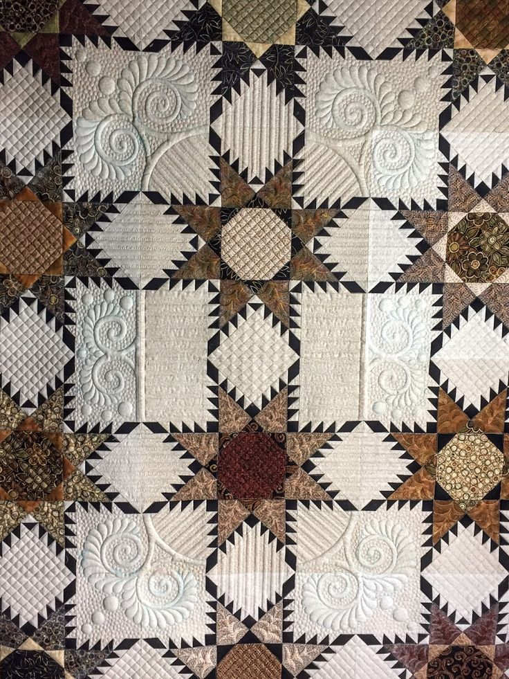 Quilting by Jan Hutchison: Feathered Star quilt for client.