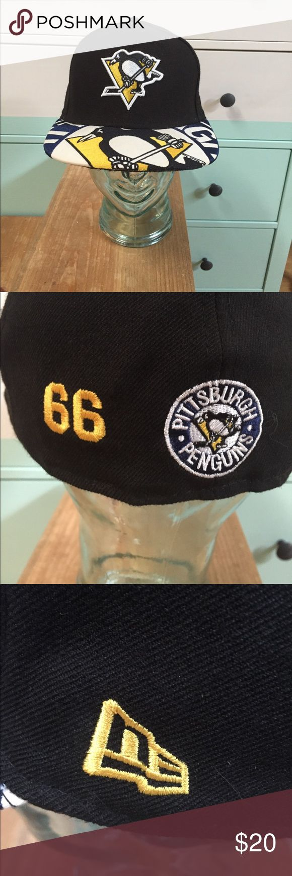NEW ERA 59FIFTY fitted PITTSBURGH PENGUINS cap NWT! Penguins are flightless birds, but you'll be FLY in this 7 1/2 fitted NEW ERA cap with custom #66 Mario Lemieux embroidery! The graphic on the brim makes this even better, and the 59FIFTY line is pro gear for a pro attitude. Never worn -- sat on display. See New Era's website for sizing info. Let's Go Pens!!! 🖤💛 New Era Accessories Hats