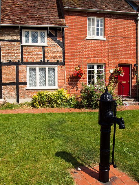 An old pump in front of cottages at Southwick in Hampshire by Anguskirk, via Flickr