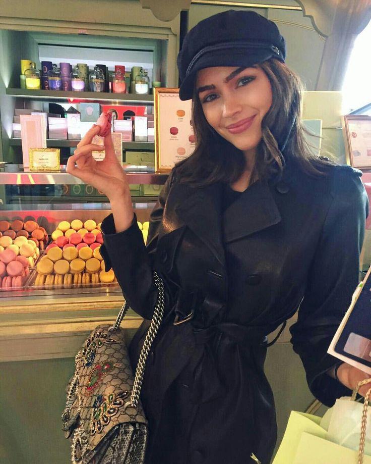 hat + black trench coat + bag /Olivia Culpo