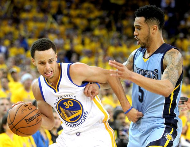 May 5, 2015 - Memphis Grizzlies Courtney Lee, right, fouls Golden State Warriors Stephen Curry, left, during Game 2 in Oakland. (Nikki Boertman/The Commercial Appeal)