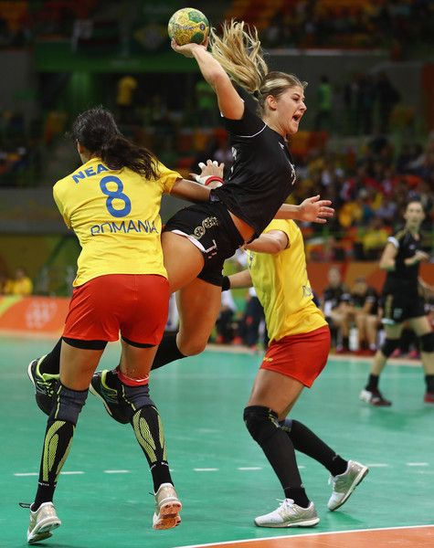 Majda Mehmedovic of Montenegro is challenged by Cristina Neagu of Romania during the Womens Preliminary Group A match between Romania and Montenegro at Future Arena on August 10, 2016 in Rio de Janeiro, Brazil.