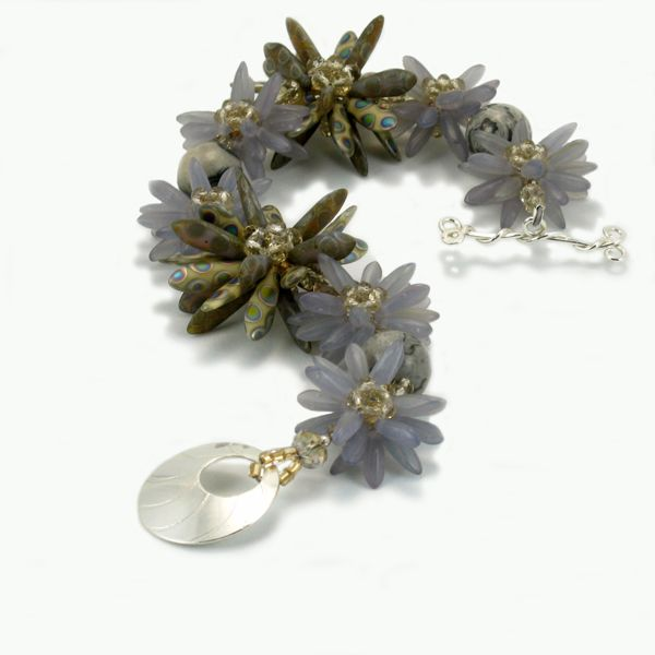 Garden bracelet, with Sterling silver handmade toggle closure. Created with Czech glass dagger beads and Swarovsky crystals. $186.00 #statementjewelry #handmade #jewelry #bracelet #handmadejewelry #fashion